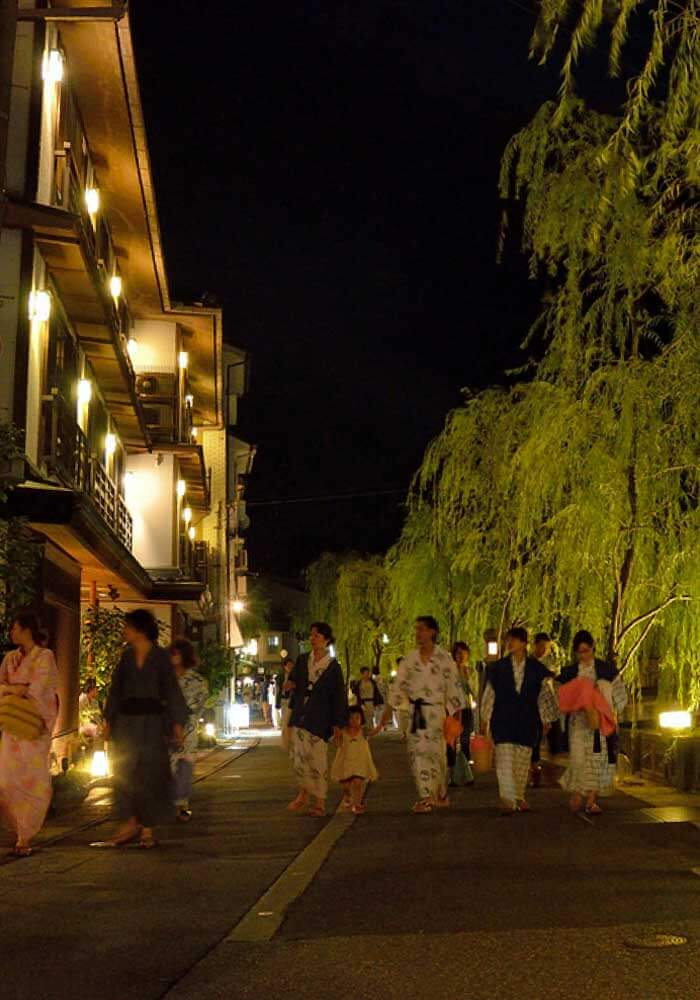 Kinosaki Onsen traditional 3 story wooden buildings line the river