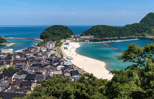 Explore the seaside town and beach in the afternoon