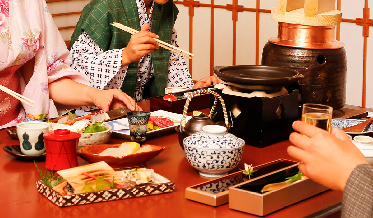 A family of three eating a kaiseki set-course dinner