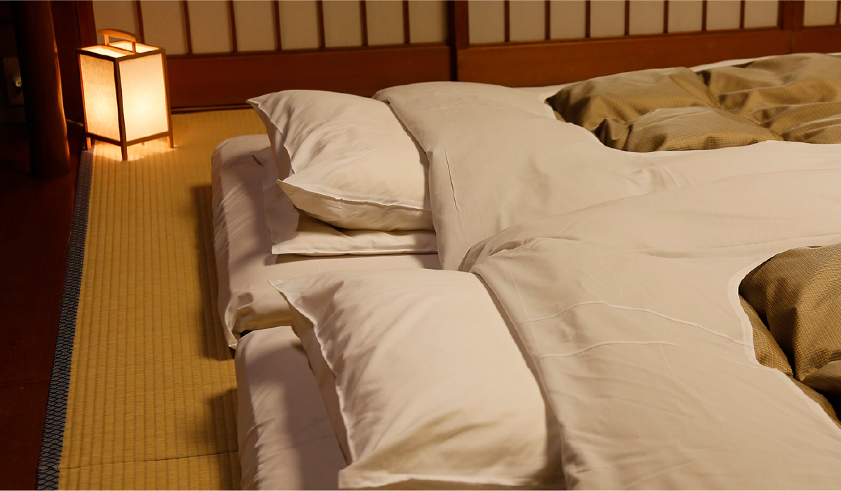 Two futon beds all prepared ready to be slept in